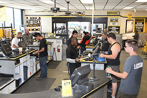 Pick-n-Pull store that is filled with people buying used auto parts