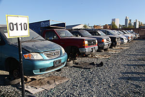 A salvage yard lined up with vans and trucks